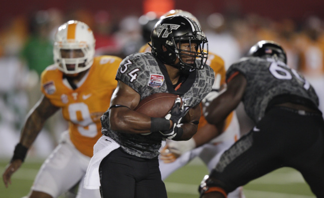 Virginia Tech running back Travon McMillian (34) carries the ball against Tennessee during the first half of an NCAA college football game at Bristol Motor Speedway on Saturday, Sept. 10, 2016, in Bristol, Tenn. (AP Photo/Wade Payne)